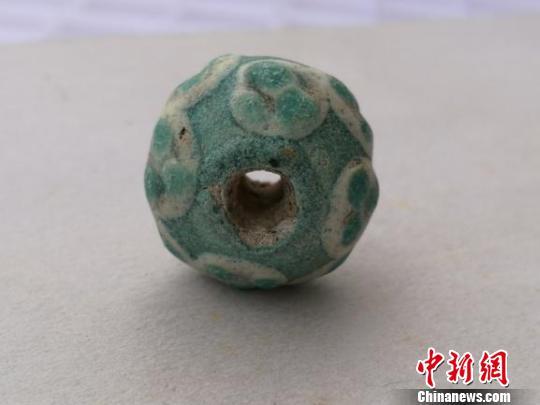 考古表明vwin德赢平台出土战国时期玻璃珠为中国先民自制